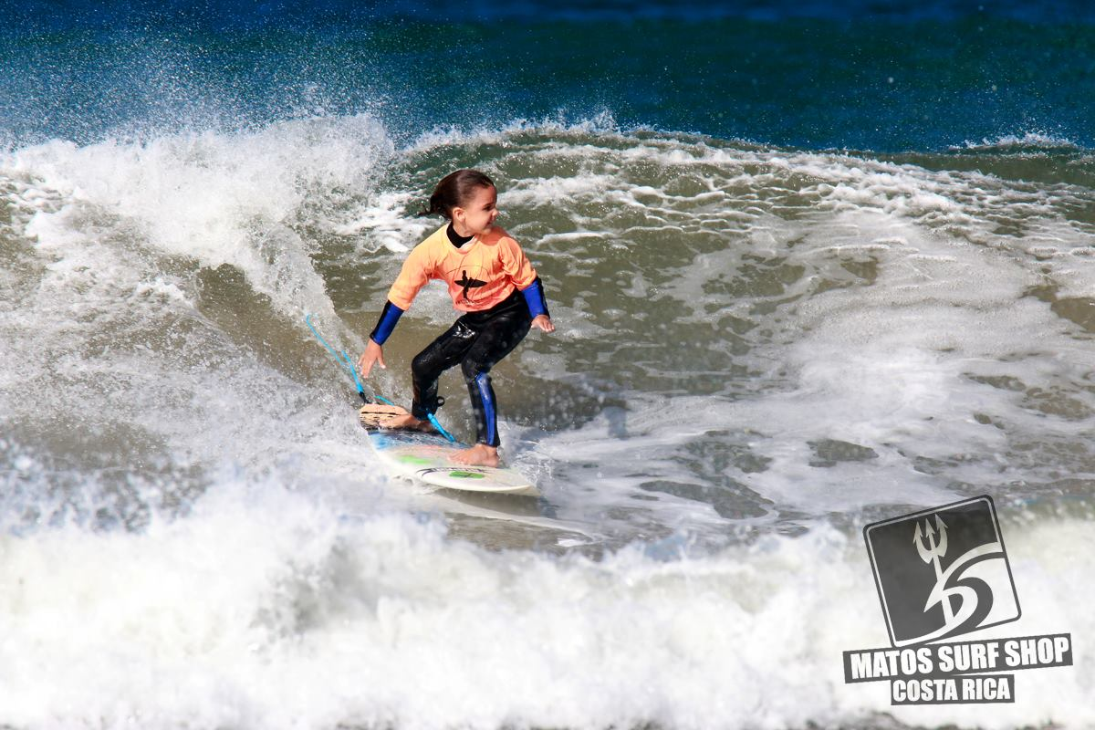 Owners' son Finnegan at 6 years old surfing a contest