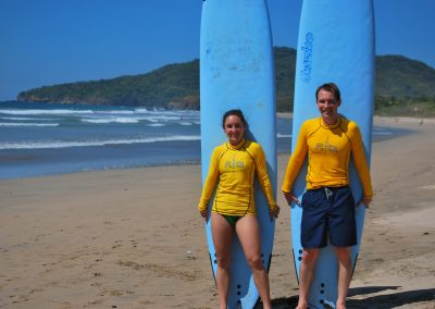 Couples having fun with surf lessons Frijoles Locos Playa Grande